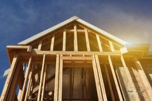 Wooden home framing in sunlight