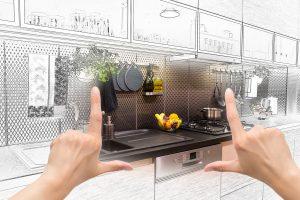 Hands framing kitchen design concept