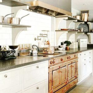 Kitchen with bronze oven and open shelving