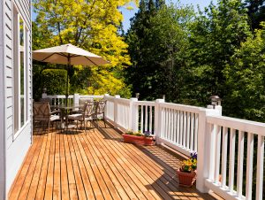 Home outdoor cedar deck with blooming trees