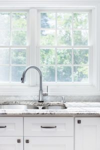 Kitchen sink and faucet with marble countertops