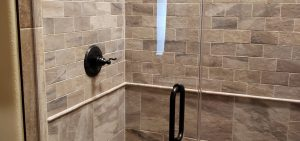 Stone shower with glass doors