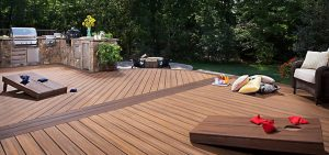 Wooden deck with a grill and cornhole boards