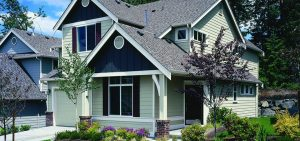 Exterior of two story light colored house with dark blue trim