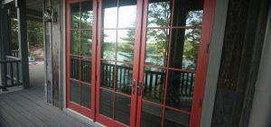 Glass exterior door with red trim.