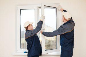 2 people installing a window